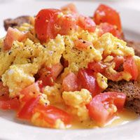 Tomato-Egg Scramble : OMG I have been loving this stuff since I was a kid! And with fried potatoes... mmmmm heaven :)