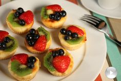 Mini low-fat cheesecakes with strawberries, kiwis and blueberries made in the NuWave Oven. I LOVE my NuWave, and these look cute and tasty!