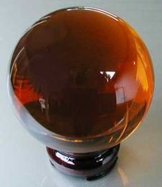 Amber Crystal Ball -Incensewoman Amber - Allows the body to heal based on transforming negative energy into positive energy. A good health stone. Well, I dunno 'bout that, but sure it purty Amber Crystal, Crystal Sphere, Crystal Ball, Minerals And Gemstones, Rocks And Minerals, Stones And Crystals, Gem Stones, Rocks And Gems, Amber Jewelry