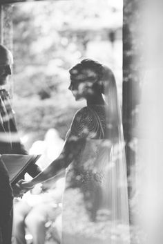 A peaceful black and white shot of a bride and groom exchanging wedding vows.