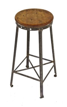 original c. 1930's american antique industrial four-legged riveted joint angled steel freestanding factory stool with maple wood seat