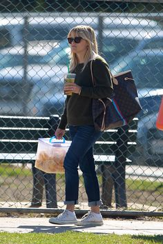 Reese Witherspoon soccer style - sweatshirt, rolled up jeans and chucks