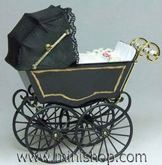 Dollhouse miniature black Victorian pram.  One inch scale. Made by Heidi Ott Miniatures, Switzerland.