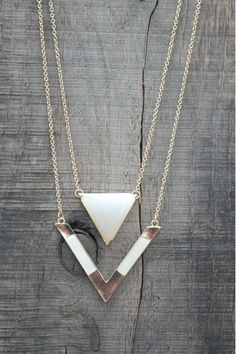 Boho Chic! Check out this new gold Triangle Double Layer Necklace! Available now at www.herringstonesboutique.com!