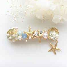 ヒトデとシェルのマリンバレッタ(ホワイト×ブルー)   ハンドメイドマーケット minne Uv Resin, Hair Beads, Beaded Jewelry Patterns, Diy Hair Accessories, Diy Earrings, Resin Crafts, Hair Jewelry, Diy Hairstyles, Hair Pieces