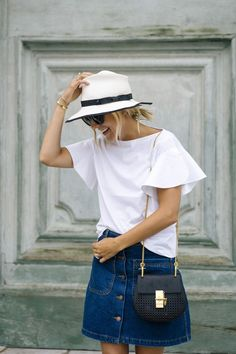 White top with denim skirt and black crossbody bag. | Summer Style