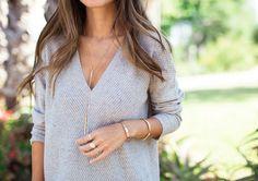 Light gray, overside sweater, gold jewelry