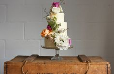 Baker and cake maker extraordinaire Laura of Yolk creates the most wonderfully decorated cakes - we adore her floral extravaganzas. A sweet home based business offering utterly delicious treats. #weddingcake #cakes #wedding #littlebookforbrides