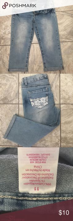 New never worn distressed denim & lace Capris NEW NEVER WORN distressed denim capris. Button fly awesome lace accent on front pockets and back. Perfect summer casual look. Pair with tank & flip flops & you are ready to go Pants Capris