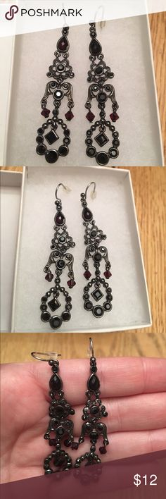 Black and black cherry red earrings Black and black cherry red earrings.  They look all black in some lighting and in brighter lighting you can see the dark red of the stones. Jewelry Earrings