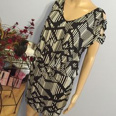 """Sexy BCBG Black & White Dress NWT BCBGeneration Dress.  95% rayon 5% spandex. Shoulder to hem length 40"""". Cute cut out shoulders. Open back. Across bust 21"""". Elastic waist that measures 13' and stretches to 21"""". From elastic waist to hem 18"""". BCBGeneration Dresses"""