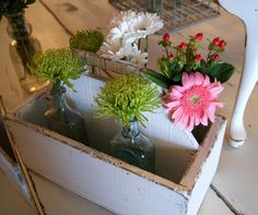 Spring flowers in an old wooden caddy