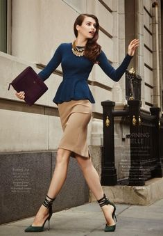 To establish authority (yet avoiding black), try a cream skirt with elegant deep blue peplum top - work wear ready. Inverted triangle body type friendly. The stappy pumps add some sass for long legs.