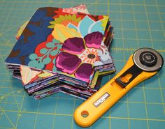 How to Cut Charm Squares - How to cut fabric to make your own charm pack DIYs.