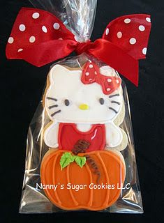 """Autumn Hello Kitty"" cookie favour - For all your cake decorating supplies, please visit craftcompany.co.uk"