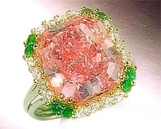 Pink diamond and emerald engagement ring.  Beautiful and unique!