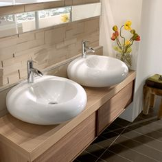 Surface-mounted bathroom sinks from Pure Stone collection