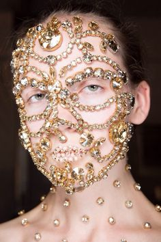 Close up of the intricate beaded faces at Givenchy by Pat McGrath
