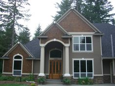 "Vinyl Cedar Shake Siding combined with regular vinyl siding and matching ""wood"" front door."