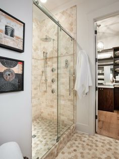 The shower space comes equipped with high-tech fixtures and clever storage.  Two remotes feature programmable settings for the shower. At the touch of a button, homeowners can wake up to a hot shower ready and waiting -->  http://hg.tv/vb0y