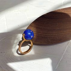 """Lapis is one of the oldest spiritual stones known to man, used by healers, priests and royalty, for power, wisdom and to stimulate psychic abilities and inner vision. It represents universal truth and is connected to the 3rd eye chakra."" Silver Core ,18k Gold-plated ,lapis lazuli and brown diamonds Diamond Rings, Gemstone Rings, 3rd Eye Chakra, Brown Diamonds, Psychic Abilities, Lapis Lazuli, 18k Gold, Sapphire, Core"