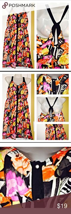 Silence + Noise Rose Garden Dress Beautiful mini dress covered in red, yellow, purple, and peach roses. Dress gathers at the waist and there are vertical false snaps. 100% polyester silence + noise Dresses Mini