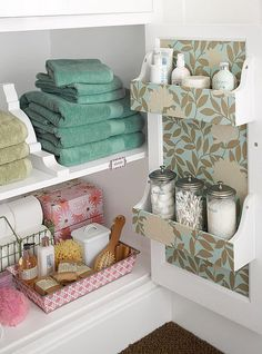 Bathroom Organizing Storage Ideas! I love the scrapbook paper on the inside of the cabinet. I'm gonna do this and use mason jars.