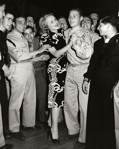Marlene Dietrich dances with a soldier at the Hollywood Canteen