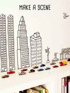 The Awe Moment: small toys in mass + a simple backdrop // #kids #cars