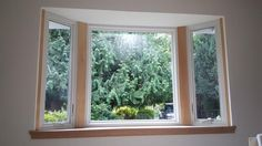 Classic Bay Window with Fibrex Pine Interior improves the energy efficiency for this 1970's home.