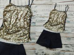 $135. www.lavidrierita.com.ar Musculosa de lentejuelas con espalda negra lisa ideal para armar tu outfit de noche. La Vidrierita. Elegís, comprás y te llega a tu casa!