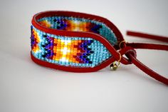 tribal loom woven leather bound cuff. $57.00, via Etsy.