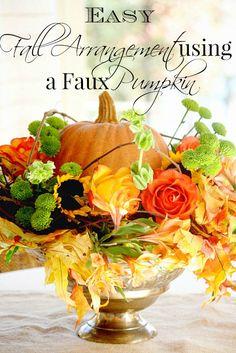 Easy Fall arrangement using a faux pumpkin. Create a beautiful fresh floral arrangement with a faux pumpkin and grapevine wreath.