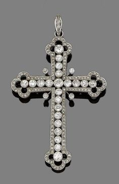 An early 20th century diamond cross pendant.  The Latin cross of openwork design with trefoil terminals, collet-set with graduated old brilliant-cut diamonds, within a border of rose-cut diamonds, mounted in silver and gold, old brilliant-cut diamonds approx. 2.95cts total, one rose-cut diamond deficient, length 9.0cm