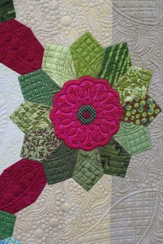 Nice quilt, Dresden Lane, but the quilting in the backgound is amazing.