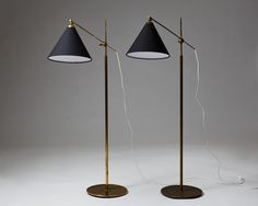 Pair of floor lamps designed by Poul Dinesen, — Modernity