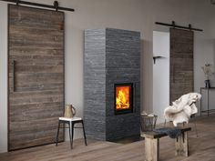 Raita is an elegantly modern soapstone masonry heater with no extra decorative touches. You can choose from the smooth, ribbed or water-cut Grafia soapstone tiles for the surface of the fireplace. Decor, House Design, Soapstone Tile, Building A House, Fire Features, Soapstone, Modern, Small Bedroom, Fireplace