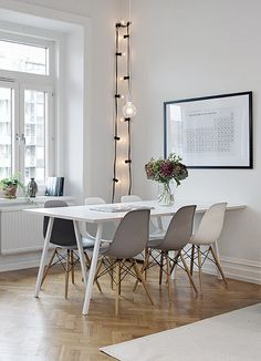 white table, eames chairs, string lamp, black white