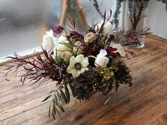Lovely wedding flowers - a little wild but I like the contrast and color introduced by the foliage