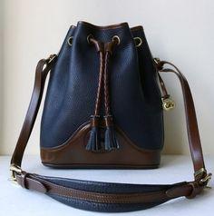 Vintage Mint XL Large Dooney & Bourke Navy and Tan Brown All Weather Pebble Leather Drawstring Tassels Bucket Handbag Crossbody Shoulder Bag...