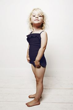 Draped Swim Suit from Mini Rodini; cute as it is, there's something a little too grown-up about this kid... (KLH)