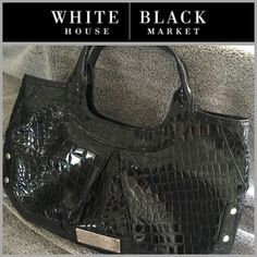 """WHBM Handbag Stylish black crocodile patent handbag. Inside of handbag is fully lined, hot pink. One zipper pocket and two smaller pockets. Handbag measures 14"""" across and almost 9"""" high. In great condition. White House Black Market Bags"""