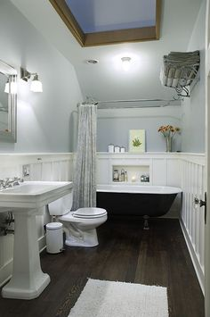 Traditional Full Bathroom with Wall sconce, Clawfoot, Wainscotting, Pedestal sink, Toto drake ii two piece toilet, Skylight