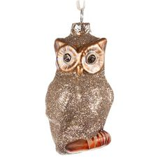 Buy Glitter Gold Owl Ornament today by Cody Foster online for the best price from thegardengates.com. Add the beautiful and delicate Glitter Gold Owl Ornament to your Christmas decor this year. This handsome Christmas tree ornament is decorated in gold glitter with goldish-bronze painted eyes and feet. Give the owl ornament as gift the wise ones in your life or hang some on your own tree this year.
