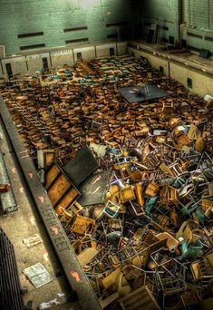 Merle Spurrier Gymnasium Pool – University of Rochester, NY, USAAfter the swimming pool was closed down it became storage for dozens of chairs and desks alike.
