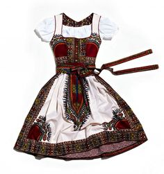 A very successful marriage of the traditional looks of two nations: Dirndl á… African Inspired Fashion, African Print Fashion, Fashion Prints, Fashion Design, African Prints, African Dresses For Women, African Wear, German Costume, African Design