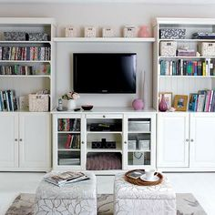 We're always on the look out for cool media set-ups. This is one of those set-ups. We're big fans of decorating around a flat screen mounted on the wall. In this scenario we especially like the vases and flowers arranged below the TV. It gives the cold, black gadget a softer edge...
