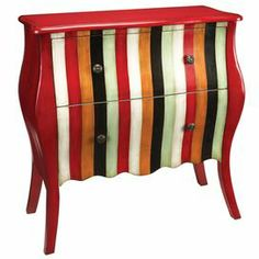 """Display a lush flower arrangement and an array of framed family photos atop this eye-catching wood chest, showcasing 2 drawers and a bold stripe motif.  Product: ChestConstruction Material: WoodColor: Red and multiFeatures:    Two drawersStripe motifDimensions: 38"""" H x 37.5"""" W x 15.5"""" D"""
