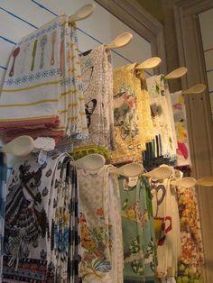 Cute way to display vintage tea towels!
