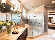 Master Bathroom with a spa feel. Carriage Hill - The Creeks, by M/I Homes. Interior Design by Mary Cook Associates. Photography by Steve Ziegelmeyer. #interiors #home #homedecor #bathroom
